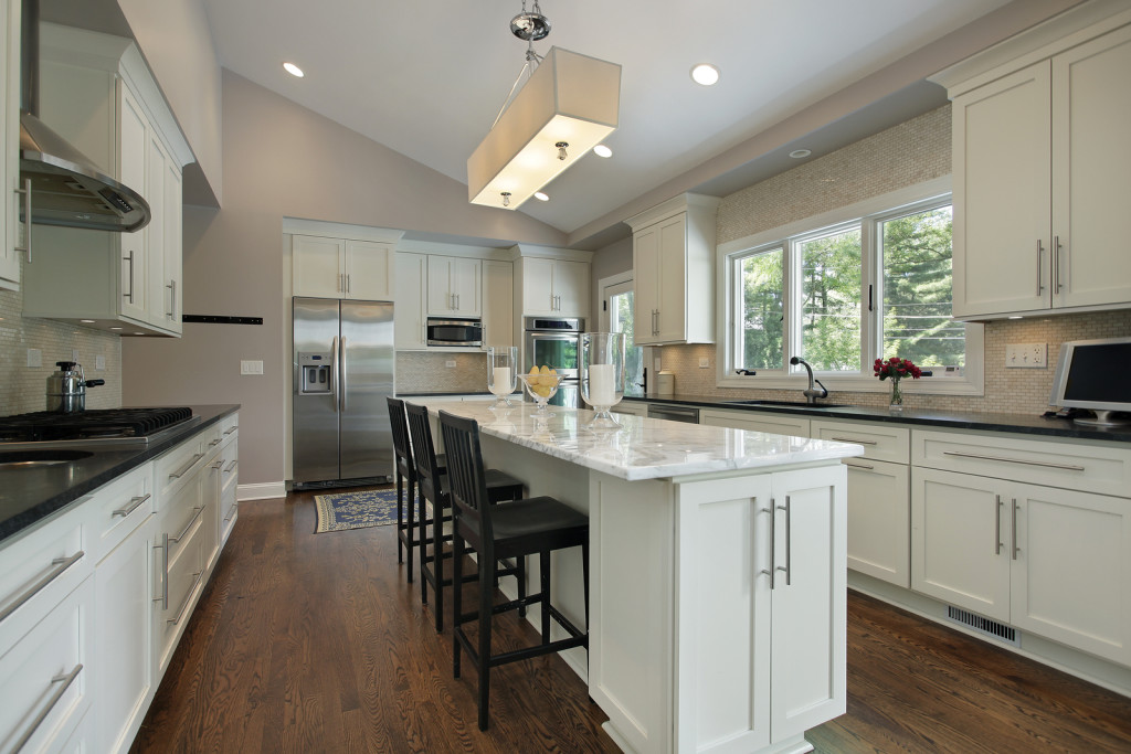 ... Kitchen in luxury home with a narrow granite counter island