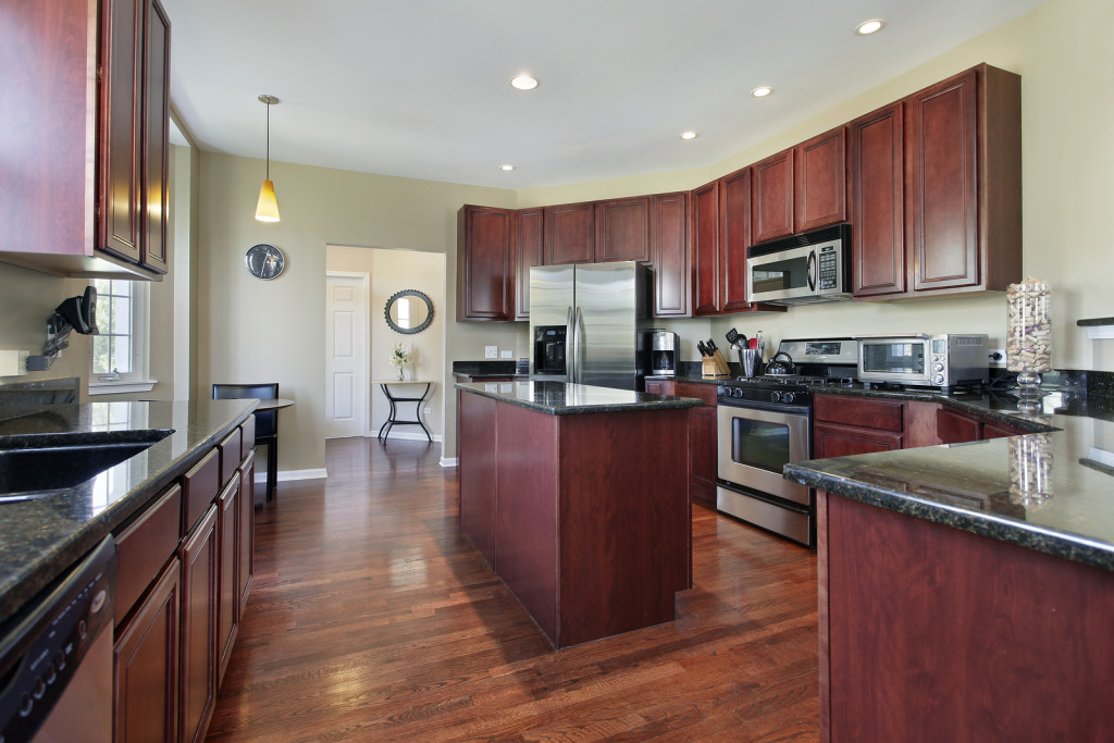 ... Kitchen In Upscale Home With Cherry Wood Cabinetry And A Narrow Cherry  Wood Island