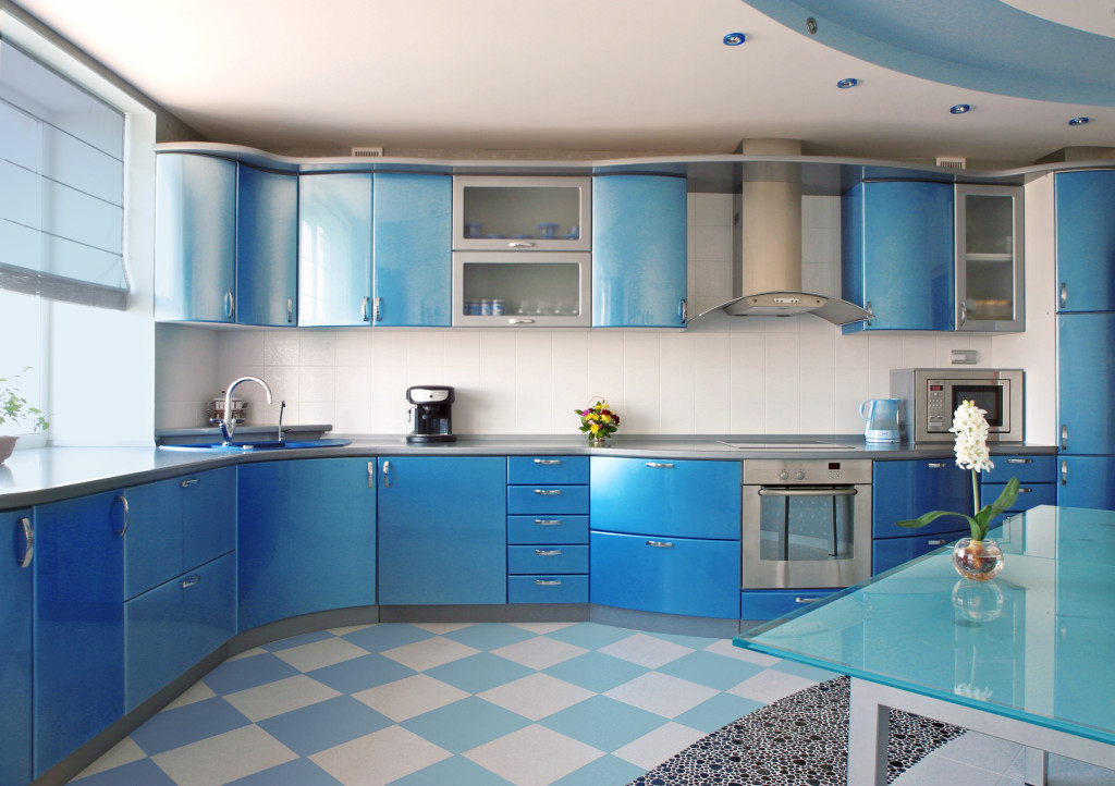 Kitchen 3: A striking blue kitchen with a flooring design which ads a modern twist onto a traditional favorite.